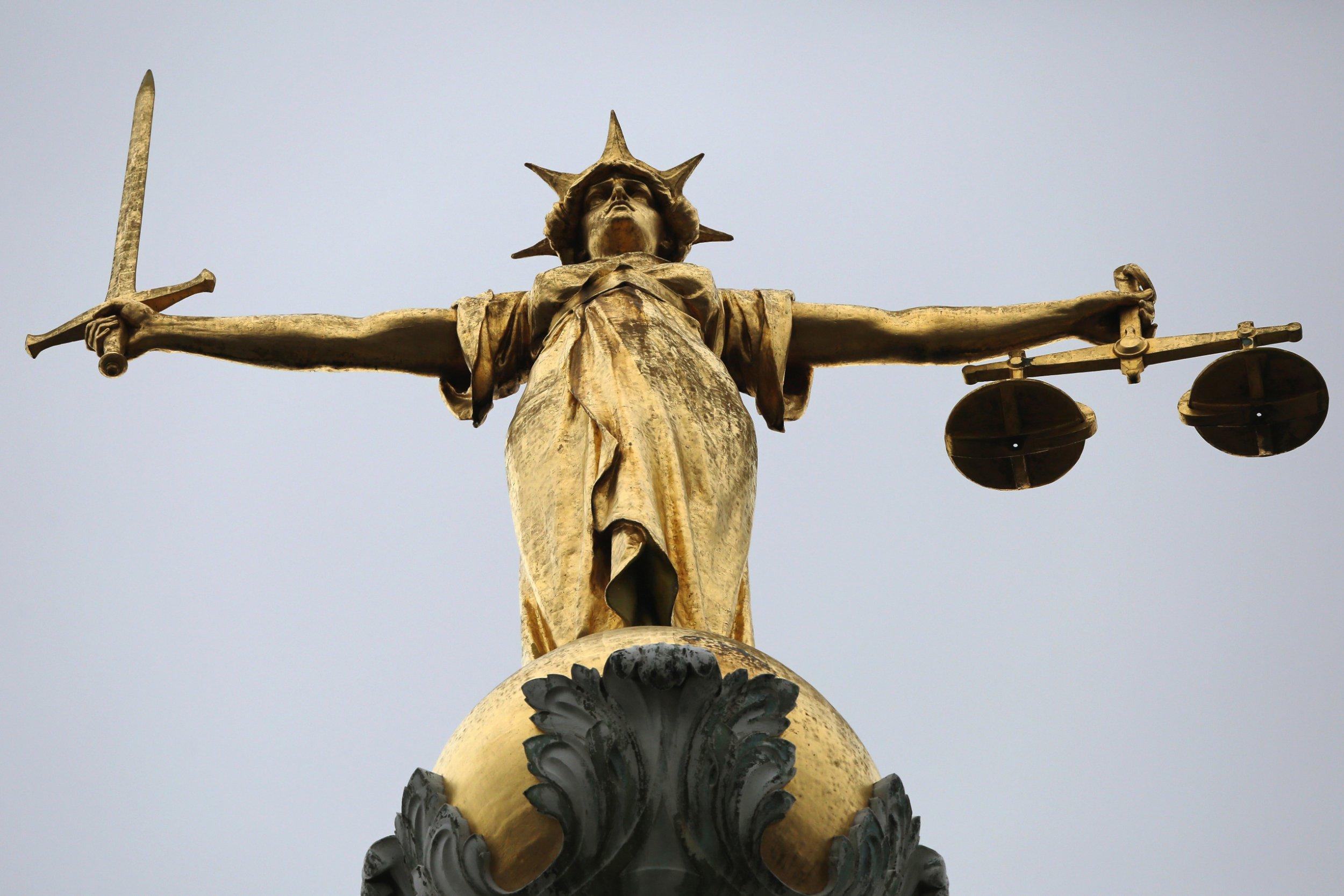 LONDON, ENGLAND - FEBRUARY 16: A statue of the scales of justice stands above the Old Bailey on February 16, 2015 in London, England. (Photo by Dan Kitwood/Getty Images)