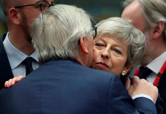 European Commission President Jean-Claude Juncker embraces with Britain's Prime Minister Theresa May attend a European Union leaders summit in Brussels, Belgium March 21, 2019. REUTERS/Yves Herman TPX IMAGES OF THE DAY