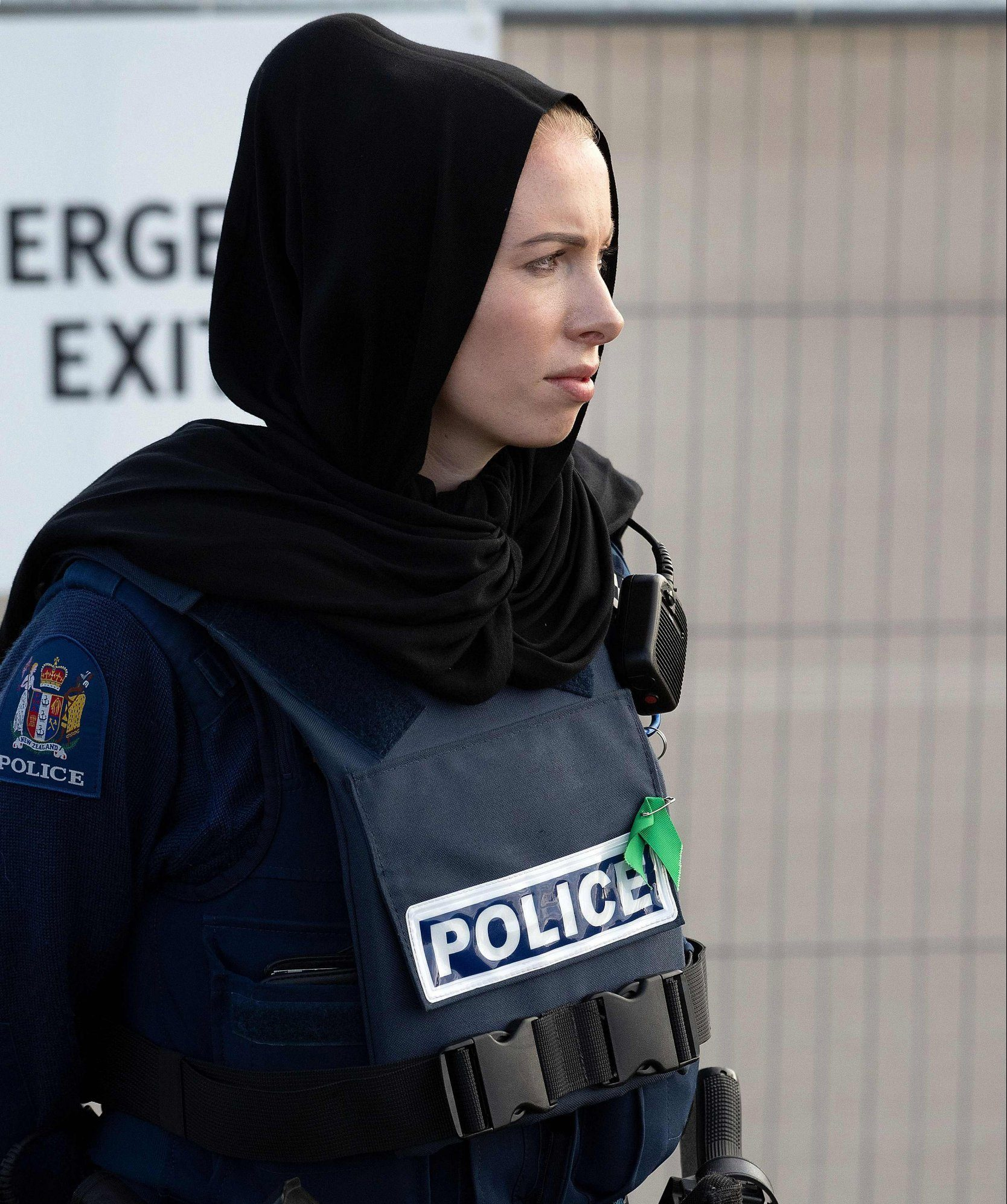 A police officer wearing a head scarf stands guard during a funeral ceremony at the Memorial Park in Christchurch on March 22, 2019. - The Muslim call to prayer rang out across New Zealand on Friday followed by two minutes of nationwide silence to mark a week since a white supremacist gunned down 50 people at two mosques in the city of Christchurch. (Photo by Marty MELVILLE / AFP)MARTY MELVILLE/AFP/Getty Images