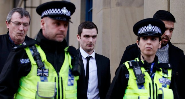 Footballer Adam Johnson (centre) leaves Bradford Crown Court after the jury went sent home for the day in his trial.