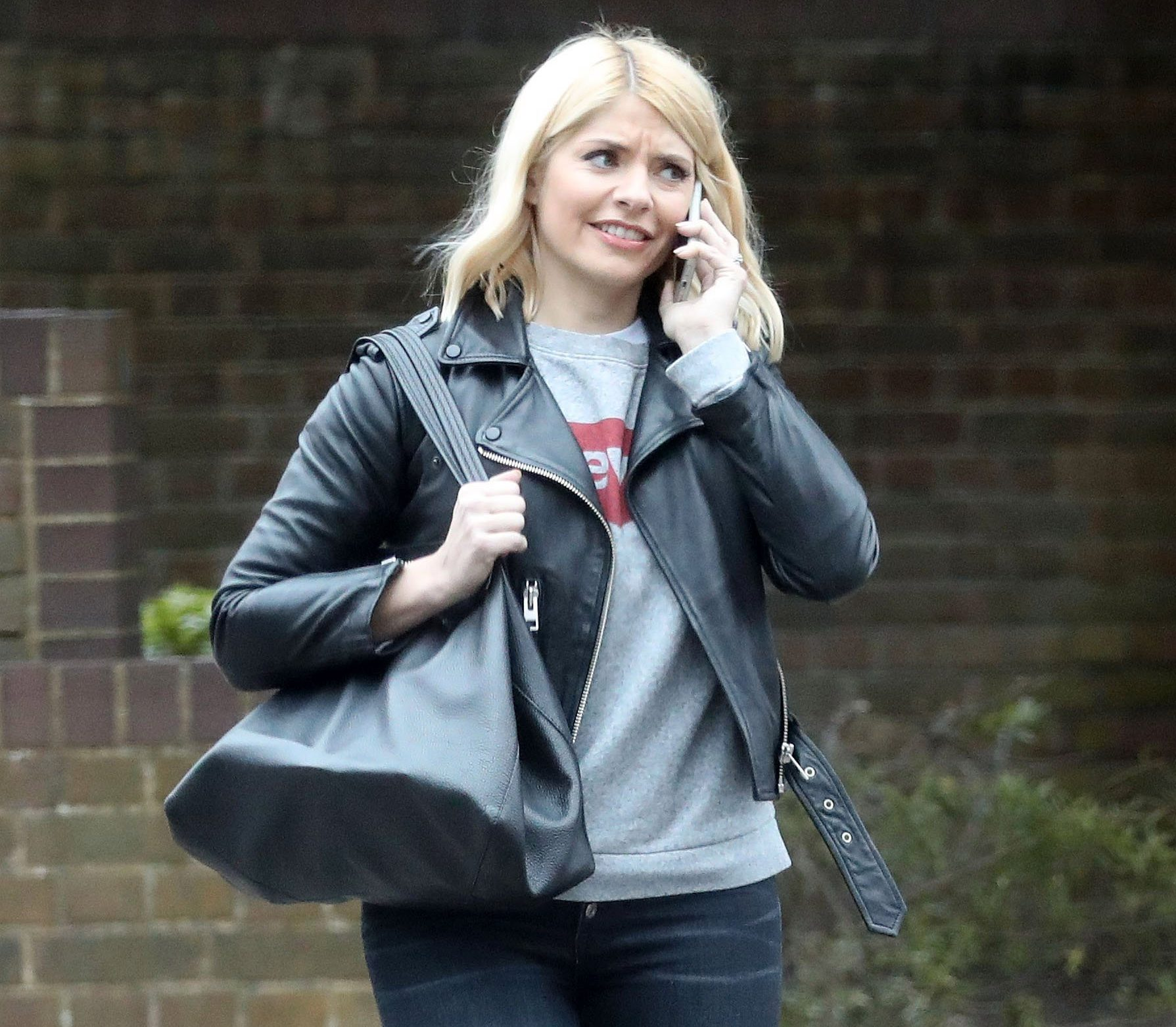EXCLUSIVE: Holly Willoughby seen running errands in West London. The This Morning host makes her way across a zebra crossing , whilst a coach ironically named 'Impact' fails to give way to the chat show host. 20 Mar 2019 Pictured: Holly Willoughby. Photo credit: MEGA TheMegaAgency.com +1 888 505 6342 (Mega Agency TagID: MEGA385342_010.jpg) [Photo via Mega Agency]