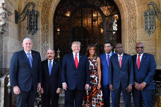 US President Donald Trump (3rd L) and First Lady Melania Trump (C) host Caribbean leaders at the Mar-a-Lago estate in West Palm Beach Florida, on March 22, 2019. - From left are: Allen Michael Chastanet, Prime Minister of Saint Lucia; Danilo Medina S??nchez, President of the Dominican Republic; President Trump; Melania Trump; Andrew Holness, Prime Minister of Jamaica; Jovenel Mo??se, President of the Republic of Haiti; and Hubert A. Minnis, Prime Minister of the Bahamas. (Photo by Nicholas Kamm / AFP)NICHOLAS KAMM/AFP/Getty Images