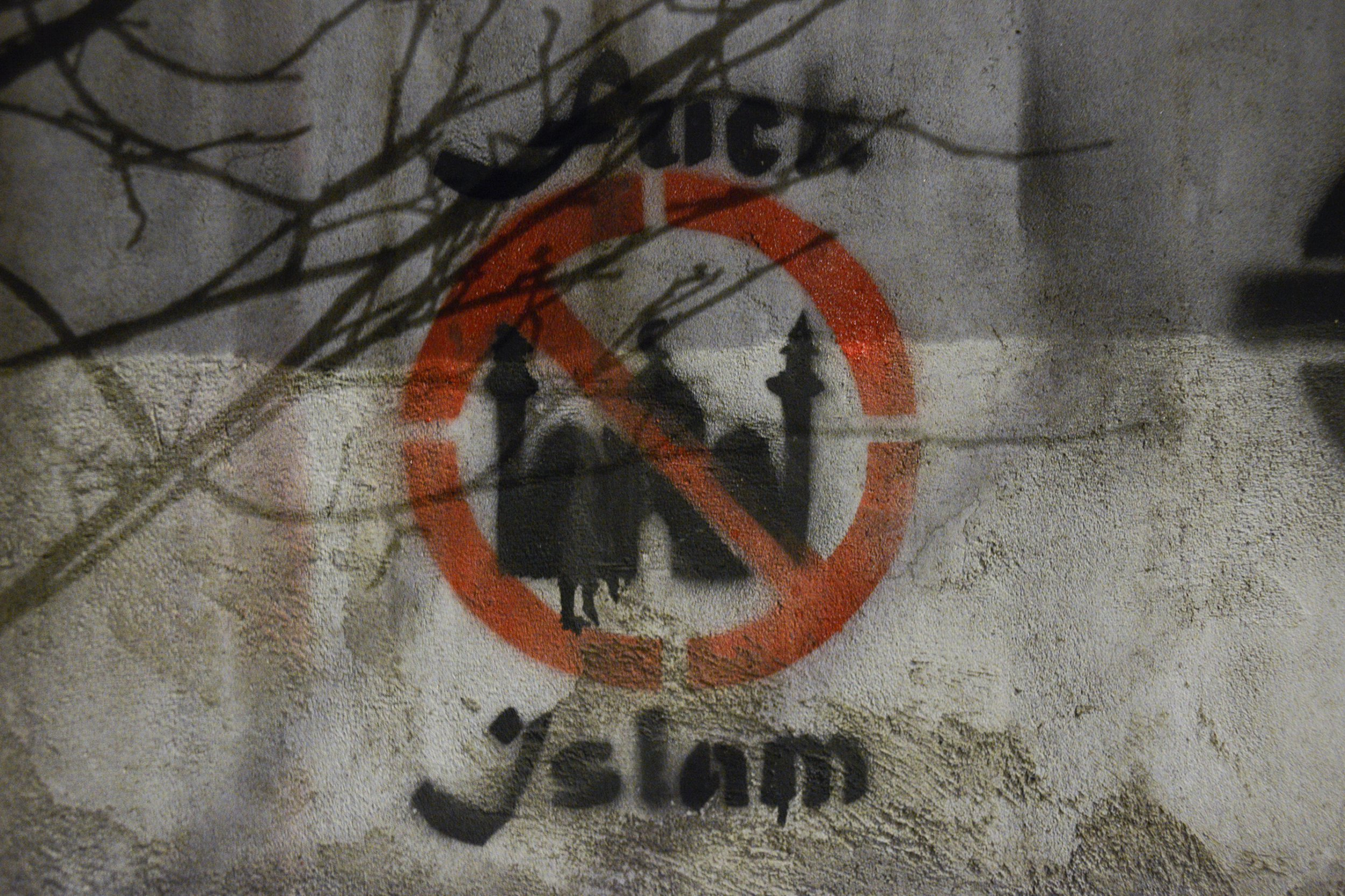 DO NOT USE - USE MUZZ VERSION An anti-Islam slogan is seen painted on a wall near the National Stadium in Warsaw, Poland on February 20, 2018. (Photo by Jaap Arriens/NurPhoto via Getty Images)