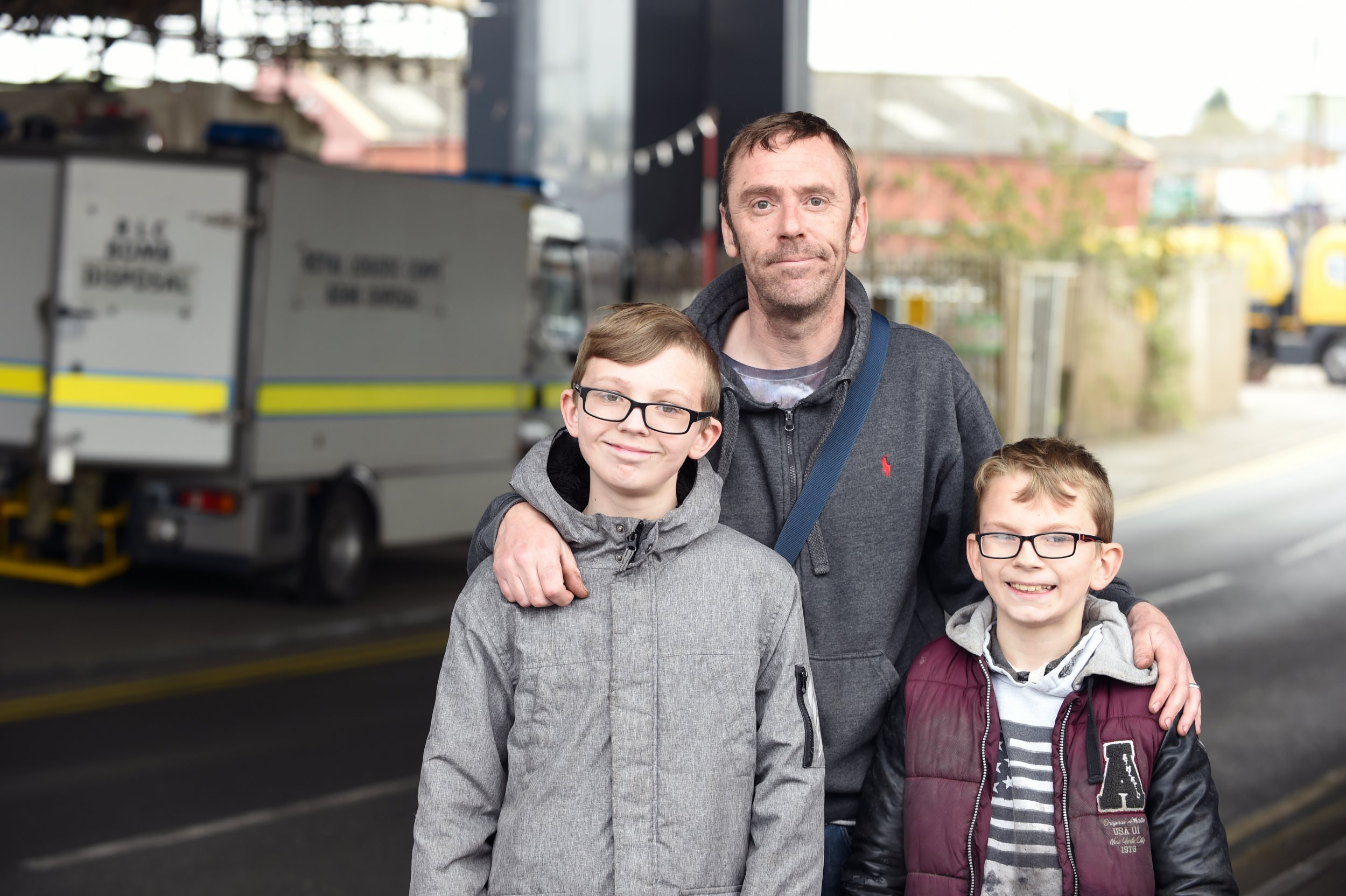 Pictured,23/3/19 Scott Harggod and his two sons , Finlay and Mckenzie while magnet fishing discover what Police belived to be a unexploded bomb. Road closed down and Army domb disposal are called. Pictured are Scott and his two sons McKenzie pictured Right and Findlay to the left of Scott centre. Also pictured are the Bomb squad and Police and the canal from where the device was fished. Also pictured is the device
