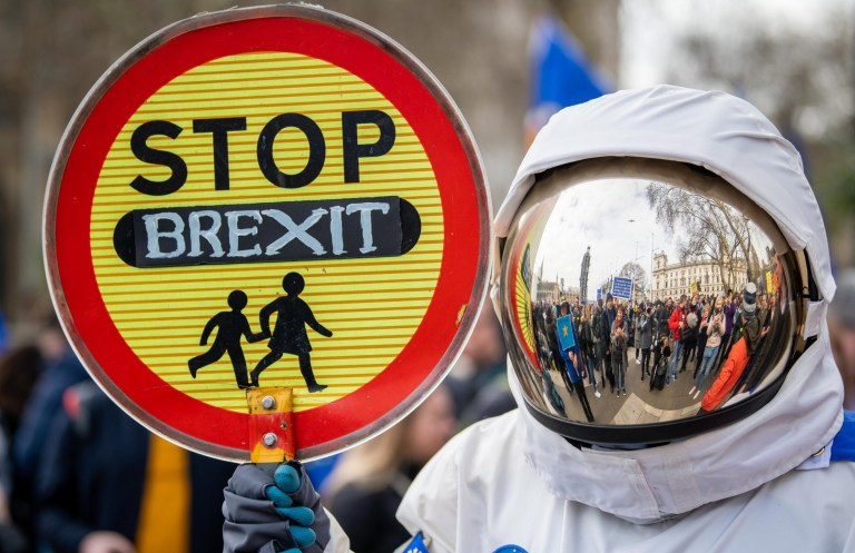 Mandatory Credit: Photo by Scott Garfitt/REX (10164648t) A protestor wears a spacesuit holding a sign during the Put It To The People March, demanding the public is given a final say on Brexit, Parliament Square, Westminster, London Put It To The People Brexit protest, London, UK - 23 Mar 2019