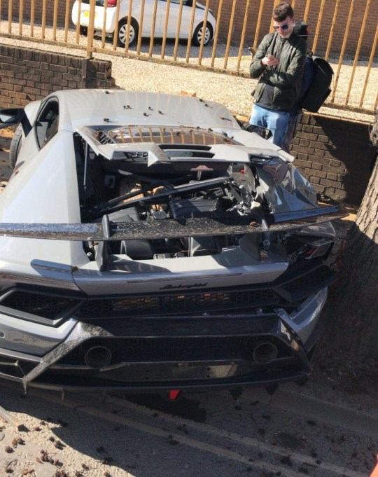 Lamborghini Huracan crashes across pavement just missing pedestrians on School Road in North Acton, London. Car had left a car event at HR Owen in North Acton. No one was injured after it crashed and knocked a wall over just missing some pedestrians. 24 Mar 2019 Pictured: Lamborghini Huracan crash. Photo credit: MEGA TheMegaAgency.com +1 888 505 6342
