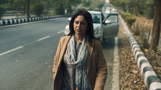 """One of Netflix's newest series, Delhi Crime, tracks the true story of an event that would change India forever. On December 16, 2012, 23-year-old Jyoti Singh and her friend, Awindra Pratap Pandey, got on a bus after seeing a showing of Life of Pi in South Delhi. The night out was supposed to be a fun break from Singh's studies; she was a medical student who had aspirations of becoming a physiotherapist. Instead, it was the last time she would ever venture outdoors again. Six men, including the bus driver, attacked Pandey before brutally beating and raping Singh for an hour, causing irreparable internal damage, before discarding her battered body on the side of the road. """"They tore my clothes and raped me in turns,"""" Singh told the police, according to The Guardian. """"They hit me with an iron rod and bit me on my entire body with their teeth. They took all belongings, my mobile phone, purse, credit card, debit card, watches, etc. Six people raped me in turns for nearly one hour in a moving bus."""" Two weeks later, Singh, whom many later referred to as """"Nirbhaya"""" (or """"fearless""""), died. Pandey, though injured, survived."""