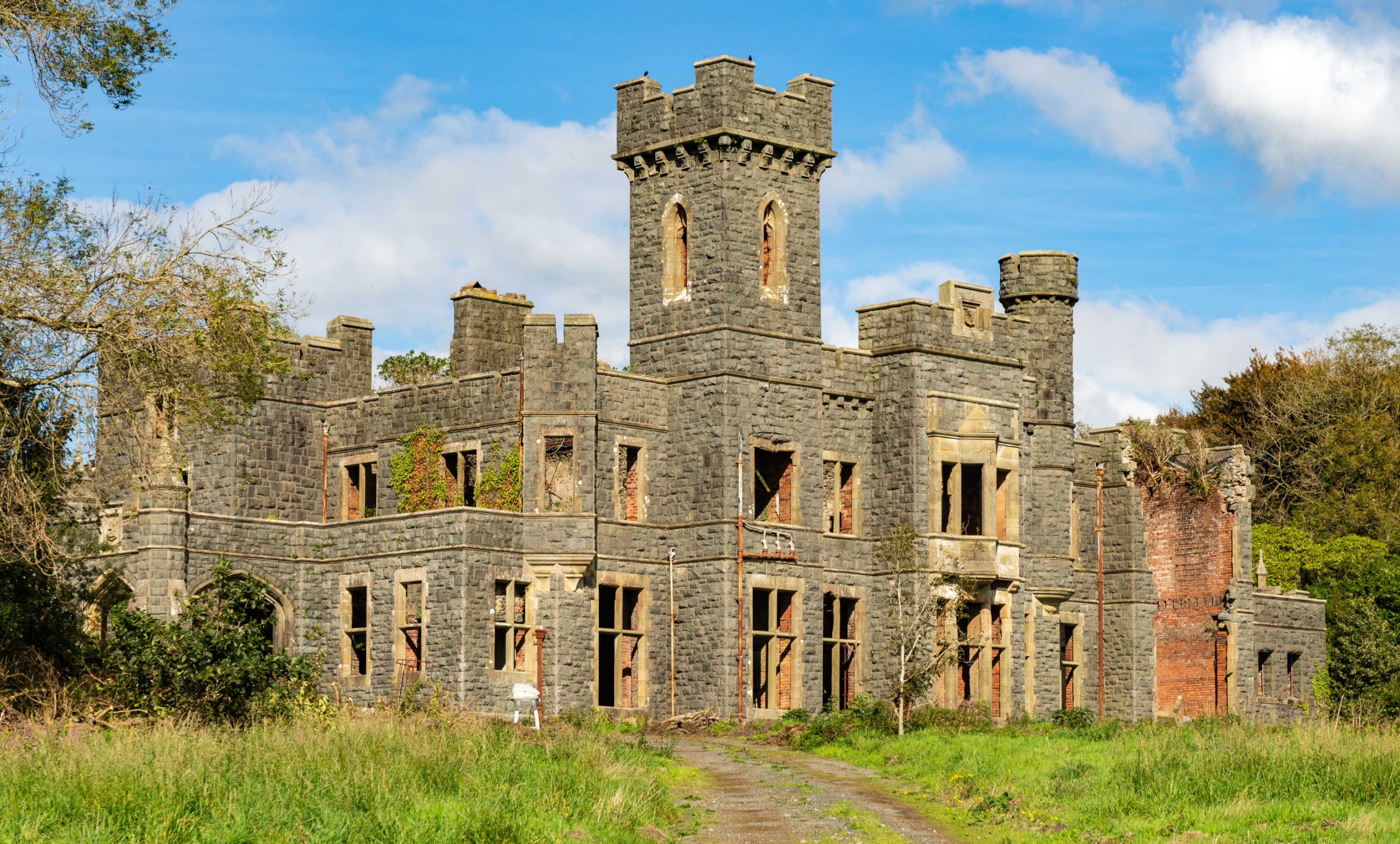 BNPS.co.uk (01202 558833) Pic: DafyddHardy/BNPS A stunning Welsh castellated mansion is on the market for a bargain ?500,000 - but it will take a brave owner to take on this ultimate DIY project. Plas Gwynfryn has no windows, floors or roof after fire ripped through the building 37 years ago and it has fallen into a derelict state since then and needs a complete restoration. The Grade II listed former mansion in Gwynedd, Wales, has been the home of an MP, a war hospital and a hotel in the last 140 years. But now it needs an ambitious new owner to save it from ruin and estate agents Dafydd Hardy warn it will be a labour of love.