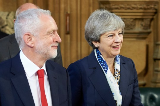 LONDON, UNITED KINGDOM - JUNE 21: Britain's Prime Minister Theresa May (R) and Britain's main opposition Labour Party leader Jeremy Corbyn (L) walk back across the Central Lobby of the Palace of Westminster from the House of Lords to the House of Commons after listening to the Queen's Speech during the State Opening of Parliament on June 21, 2017 in London, United Kingdom. This year saw a scaled-back State opening of Parliament Ceremony with the Queen arriving by car rather than carriage and not wearing the Imperial State Crown or the Robes of State. (Photo by Niklas Halle'n - WPA Pool/Getty Images)