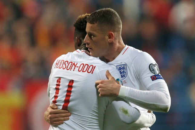 England's Callum Hudson-Odoi, left, hugs teammate Ross Barkley after he scored his side's third goal during the Euro 2020 group A qualifying soccer match between Montenegro and England at the City Stadium in Podgorica, Montenegro, Monday, March 25, 2019. (AP Photo/Darko Vojinovic)
