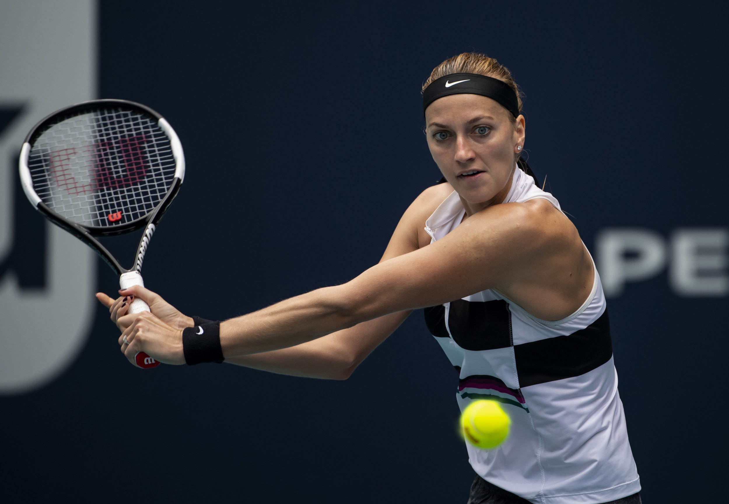 MIAMI GARDENS, FLORIDA - MARCH 25: Petra Kvitova of the Czech Republic hits a backhand against Caroline Garcia of France in the 4th Round of the women's singles at the Miami Open on March 25, 2019 in Miami Gardens, Florida. (Photo by TPN/Getty Images)