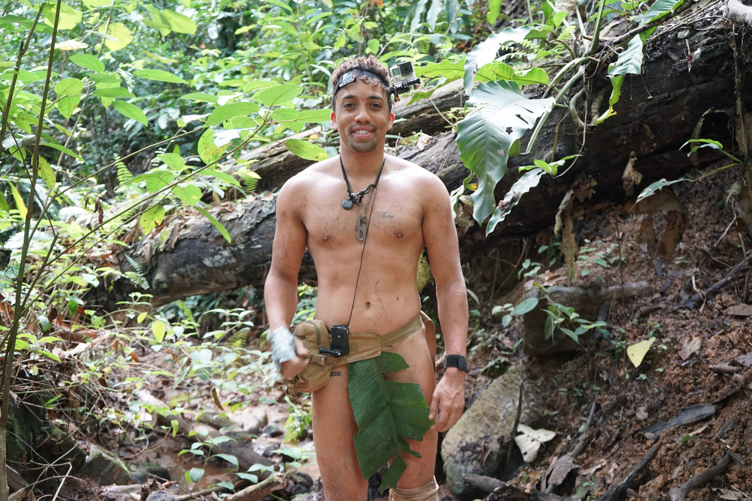 "Adventurer Daniel Olifi, 26 during his adventure. See SWNS story SWTPnaked; A pair of uni pals battled blistering heat, machete wounds, thunderstorms and hypothermia to survive three weeks in the jungle -- totally NAKED. Adventurer Daniel Olifi, 26, and his mate James Moynihan, 27, love going on unusual holidays, and wanted to see if they could survive three weeks alone in rural Malaysia. The survival junkies only took a flint rock, a machete, a mosquito net, a metal water pot and a first aid kit on their trip. Financial tech worker Daniel and cruise entertainer James endured thunderstorms, dozens of mosquito bites, hypothermia, dehydration, and pitch black sleepless nights. They lost 46 lbs between them, thanks to a diet of foraged plants and bugs. They managed three weeks close to the equator - apart from one short trip to a hospital so Daniel could get stitches after slicing his hand open with a machete. The hardy duo said they decided not to wear clothes for the adventure ""to show that it can be done"" and recorded their time in video diaries."