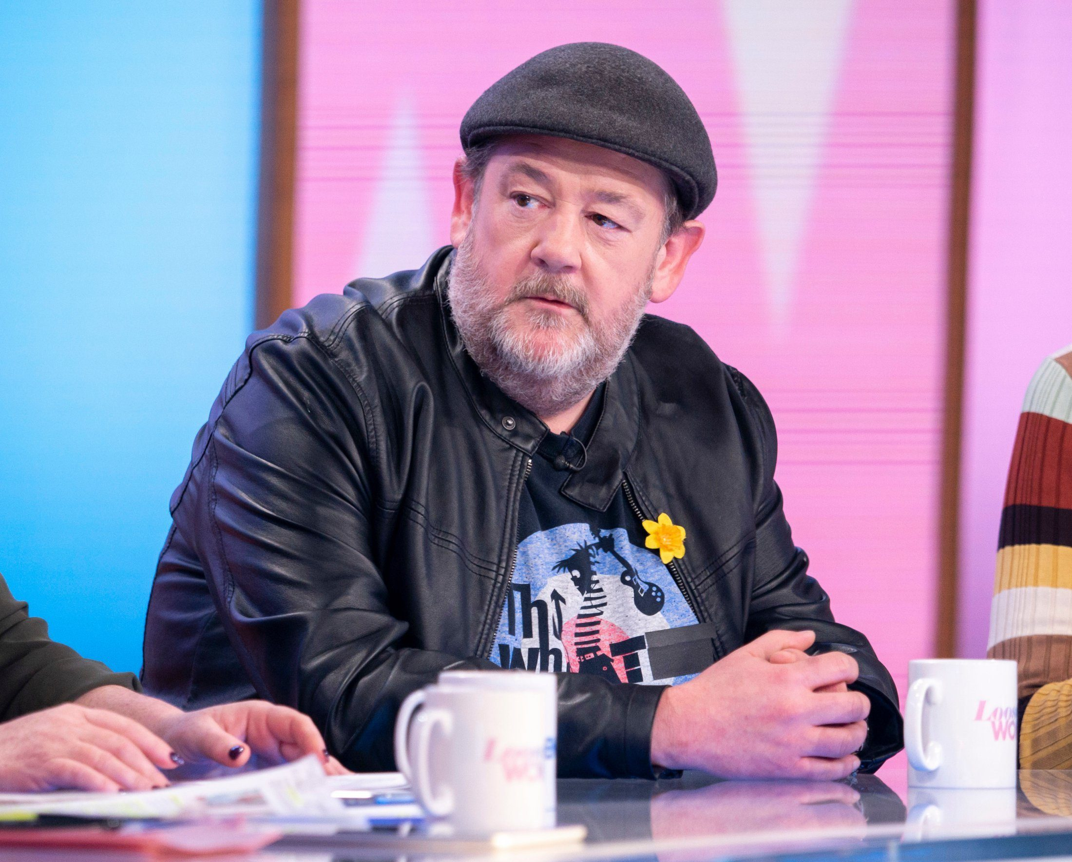 Editorial use only Mandatory Credit: Photo by S Meddle/ITV/REX (10168091cv) Johnny Vegas 'Loose Women' TV show, London, UK - 26 Mar 2019 GUEST CHAT: JOHNNY VEGAS Johnny Vegas has been a regular face on British television for over 20 years, you?ll know the comedian from his various appearances from PG tips commercials, ITV?s Benidorm to much loved British panel shows. Ahead of the release of his brand new comedy movie ?Eaten by Lions? Johnny is giving the Loose Women a visit to bring us up to speed with his latest acting role, challenges in the Bake off kitchen as well as a new Channel 4 series in the pipeline. Plus, why he feels he?s in the best shape ever!