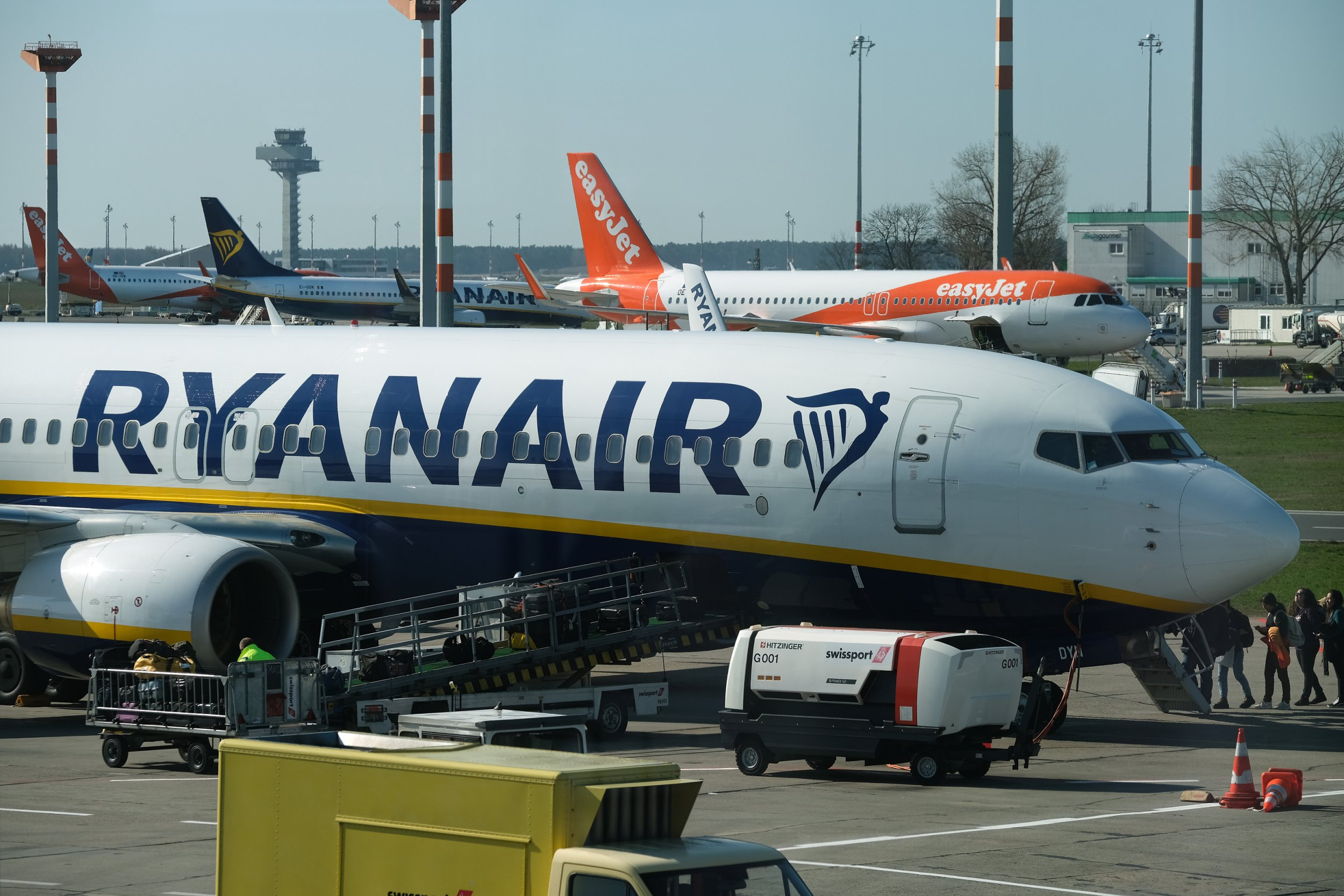 SCHOENEFELD, GERMANY - MARCH 20: Ryanair and easyJet passenger planes stand at Schoenefeld Airport near Berlin on March 20, 2019 in Schoenefeld, Germany. Schoenefeld has become a hub for the two discount airliners. (Photo by Sean Gallup/Getty Images)