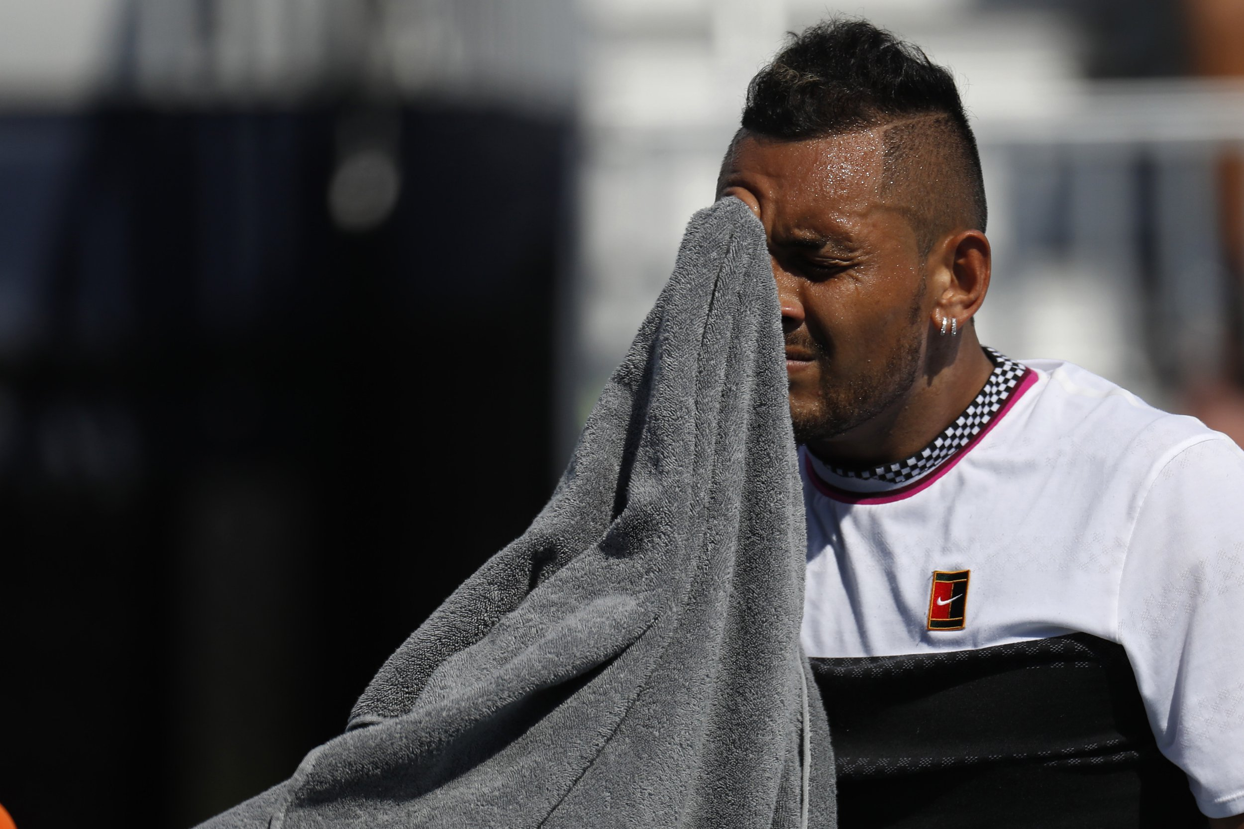 Nick Kyrgios of Australia wipes his face with a towel between points against Borna Coric of Croatia (not pictured) in the fourth round of the Miami Open at Miami Open Tennis Complex. Mandatory Credit: Geoff Burke-USA TODAY Sports