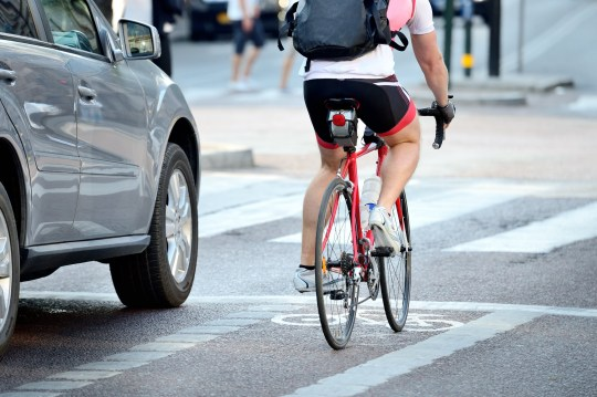 Rear view of bicyclist in full gear; Shutterstock ID 171924167; Purchase Order: -