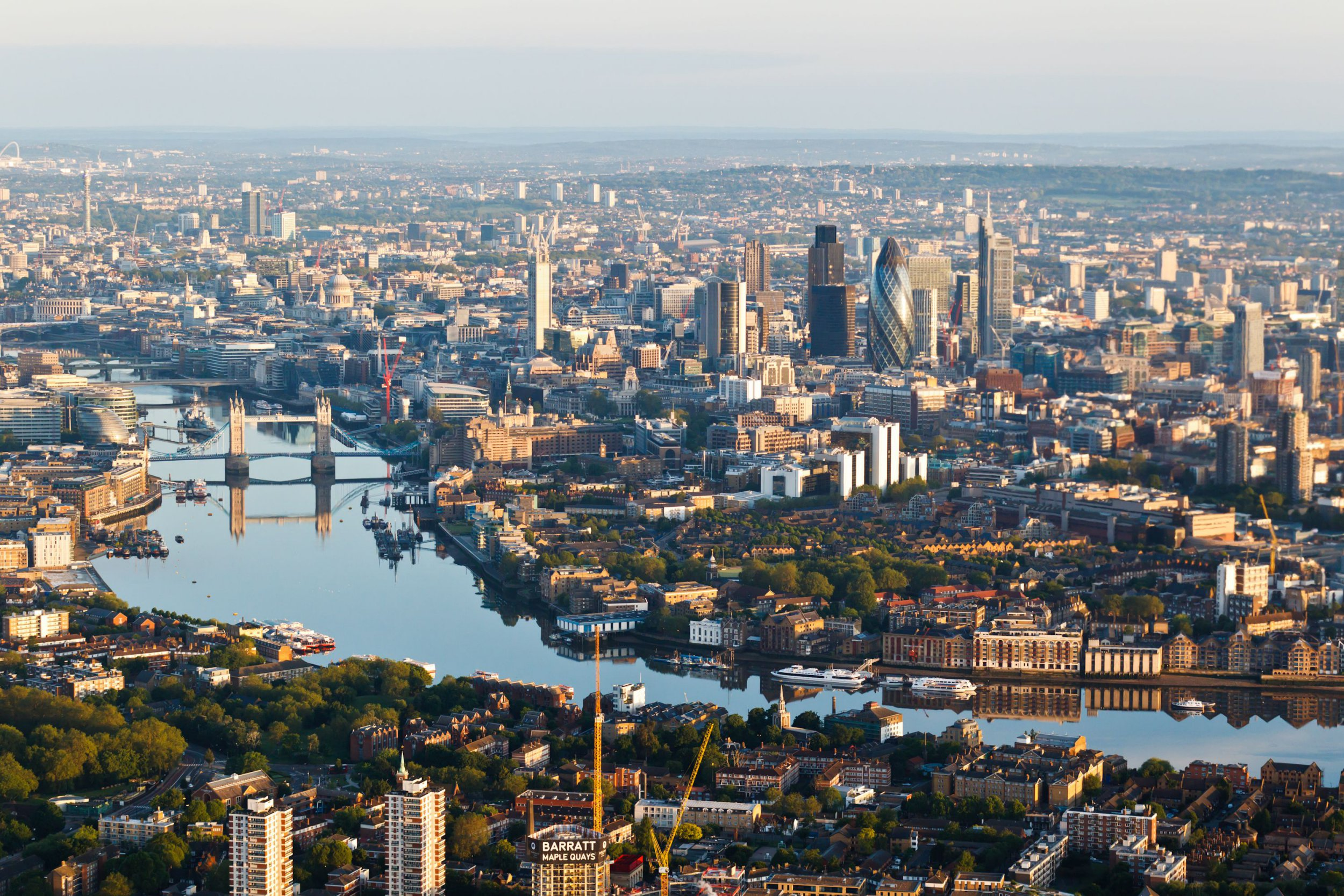 Mandatory Credit: Photo by High Level/REX/Shutterstock (1752147aj) An early morning aerial image looking West from Rotherhithe down the River Thames showing iconic buildings of the London skyline. London. Aerial photos of Britain - 2012