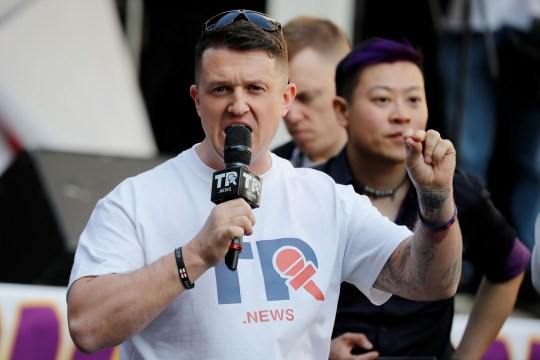 "British far-right activist Tommy Robinson addresses protesters gathered outside the Houses of Parliament in central London on March 29, 2019. - British MPs today rejected Prime Minister Theresa May's deal for leaving the European Union for a third time, raising the spectre of a ""no deal"" exit or a long delay to the process. (Photo by Tolga AKMEN / AFP)TOLGA AKMEN/AFP/Getty Images"