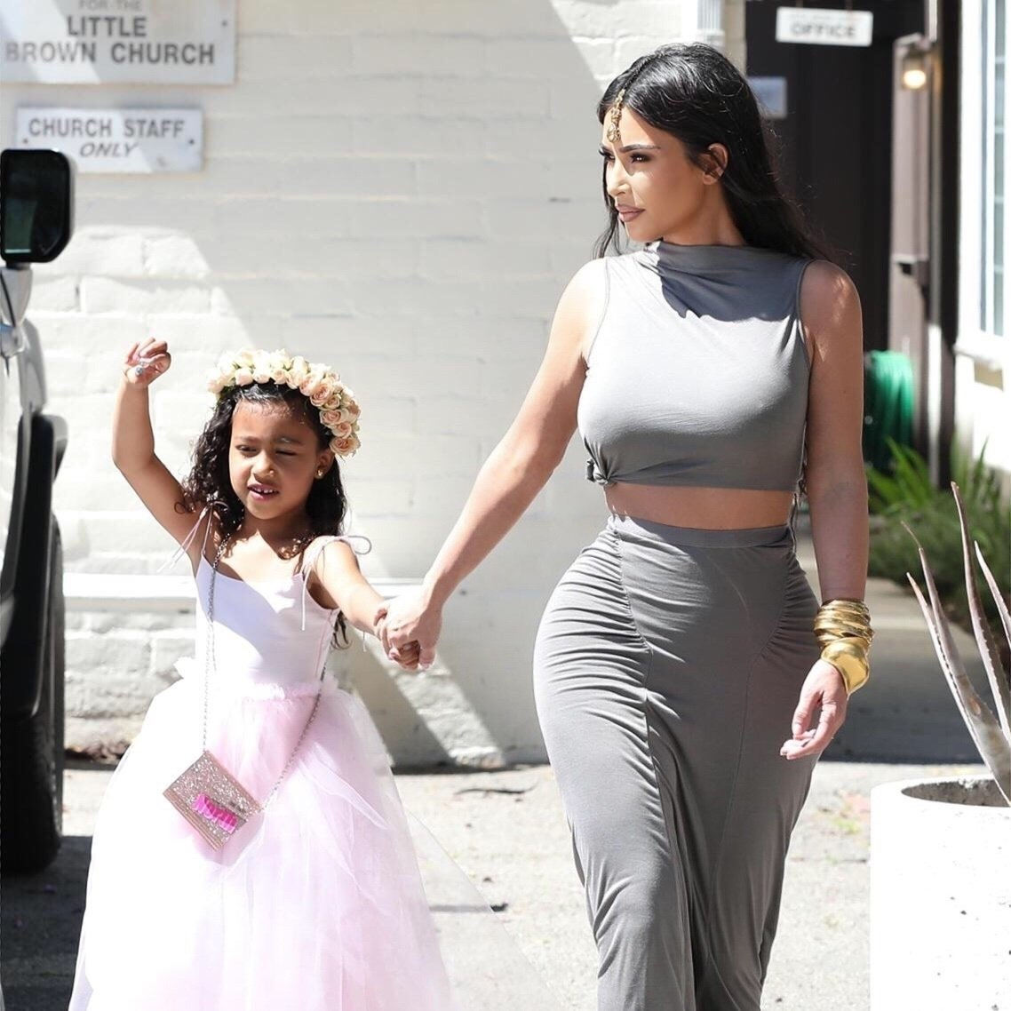 Sherman Oaks, CA - *EXCLUSIVE* - Kim Kardashian goes braless as she takes her daughter North to a wedding in Sherman Oaks. North looks cute as she dressed up as a princess for the occasion. Pictured: Kim Kardashian, North West BACKGRID USA 30 MARCH 2019 BYLINE MUST READ: Jack / BACKGRID USA: +1 310 798 9111 / usasales@backgrid.com UK: +44 208 344 2007 / uksales@backgrid.com *UK Clients - Pictures Containing Children Please Pixelate Face Prior To Publication*