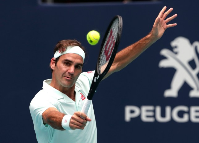 Roger Federer, of Switzerland, returns to John Isner during the singles final of the Miami Open tennis tournament, Sunday, March 31, 2019, in Miami Gardens, Fla. (AP Photo/Lynne Sladky)