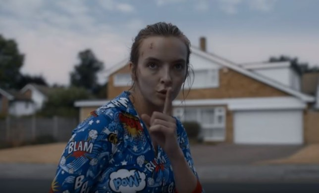 Villanelle poses with a finger to her lips to shhh someone in killing eve (picture: BBC)
