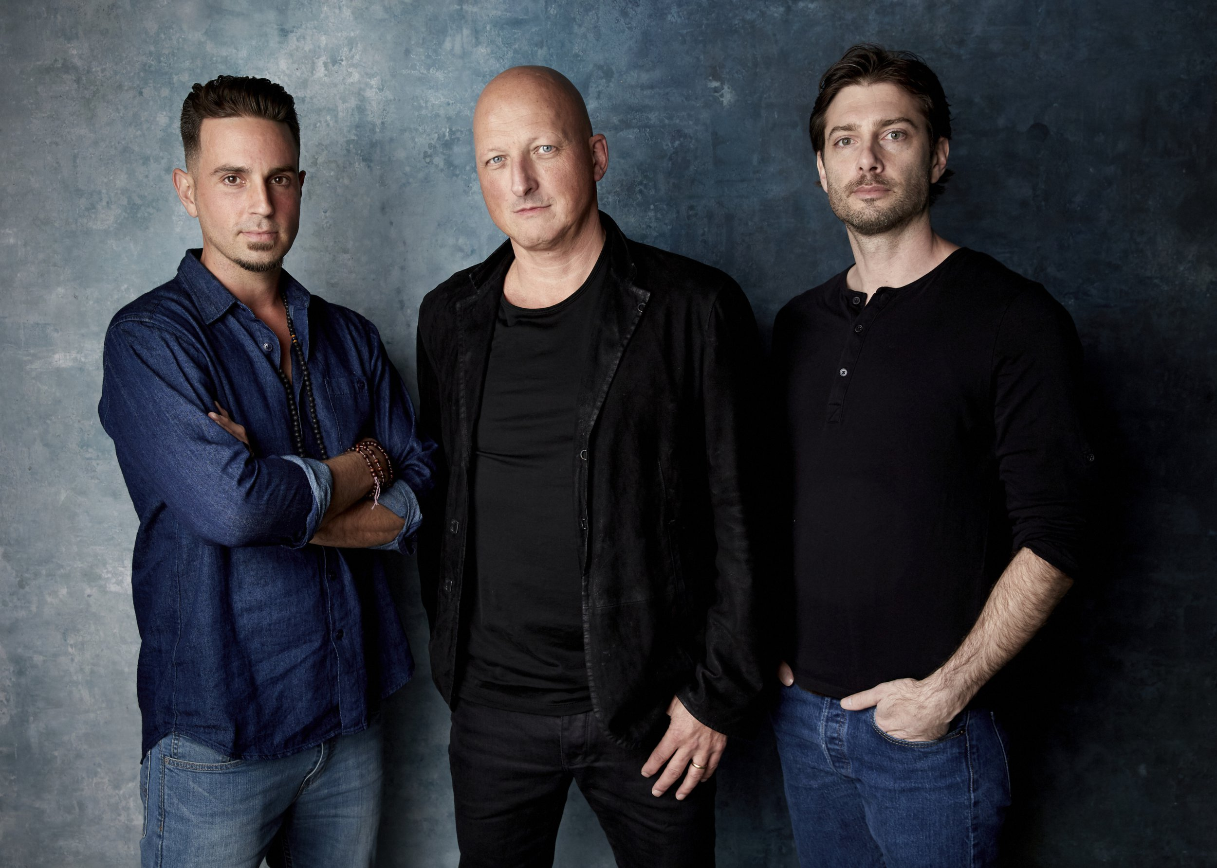 """FILE - In this Jan. 24, 2019, file photo, Wade Robson, from left, director Dan Reed and James Safechuck pose for a portrait to promote the film """"Leaving Neverland"""" at the Salesforce Music Lodge during the Sundance Film Festival in Park City, Utah. The Michael Jackson estate has sent a letter to the U.K.???s Channel 4 warning that the documentary on Robson and Safechuck, who accuse the singer of molesting them as boys violates the network's programming guidelines. Estate attorneys say in the letter released to The Associated Press on Monday, Feb. 11, that """"Leaving Neverland,"""" includes no response from Jackson defenders as the channel's guidelines require. (Photo by Taylor Jewell/Invision/AP, File)"""