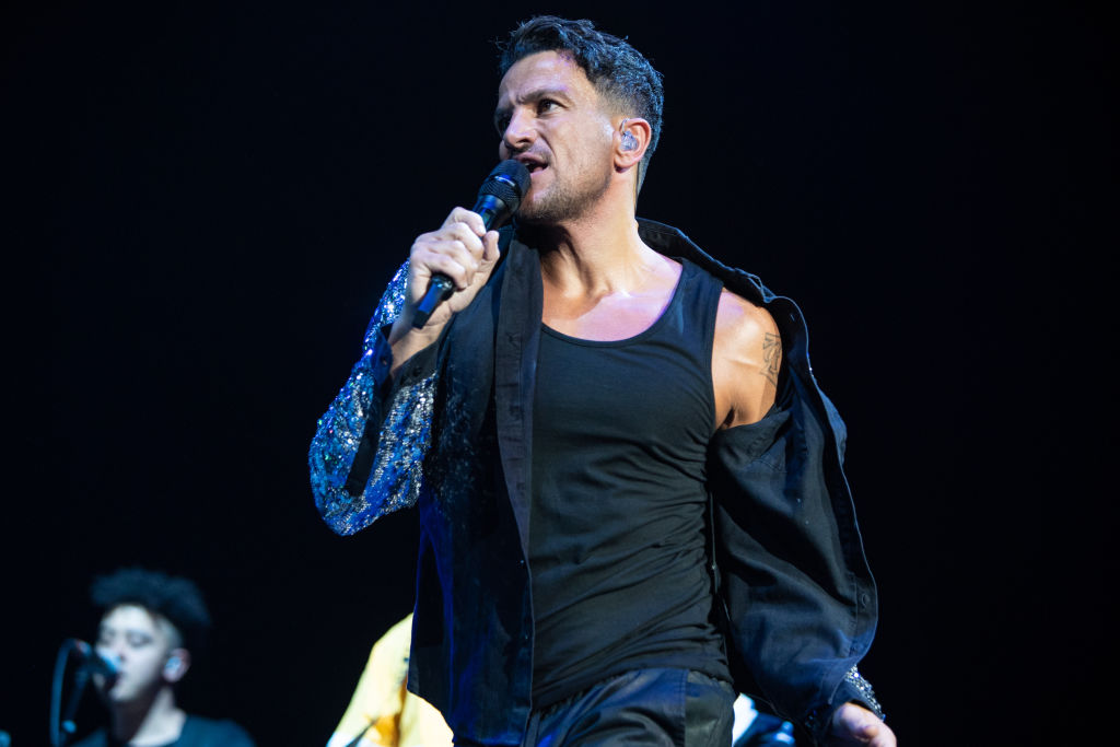 Peter Andre performing on tour