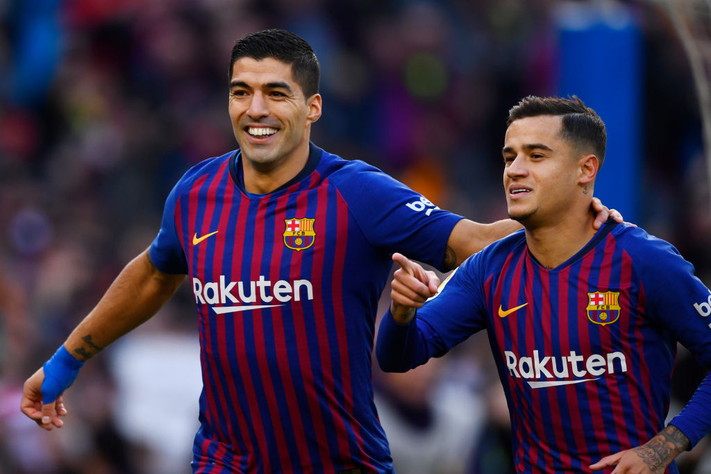 Barcelona's Brazilian midfielder Philippe Coutinho (R) celebrates a goal with Barcelona's Uruguayan forward Luis Suarez during the Spanish league football match between FC Barcelona and Real Madrid CF at the Camp Nou stadium in Barcelona on October 28, 2018. (Photo by GABRIEL BOUYS / AFP) (Photo credit should read GABRIEL BOUYS/AFP/Getty Images)