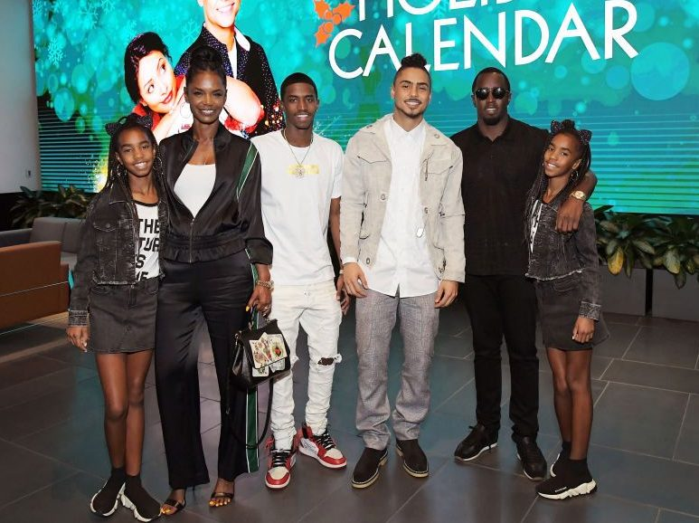 Diddy and Kim Porter with their children