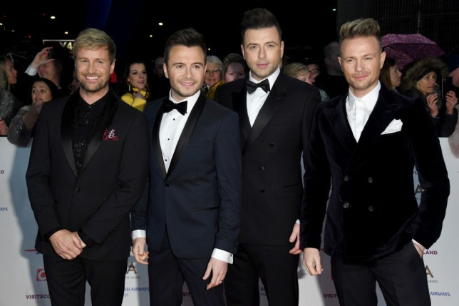 Kian Egan, Shane Filan, Markus Feehily and Nicky Byrne from Westlife in suits at the National Television Awards
