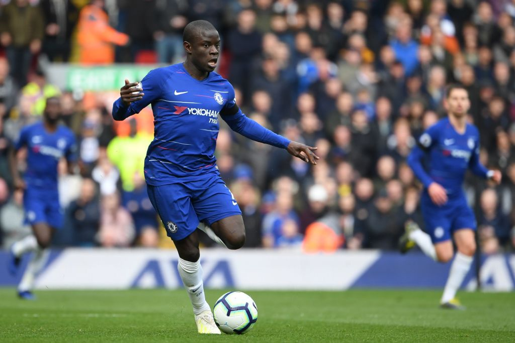 Chelsea's French midfielder N'Golo Kante runs with the ball during the English Premier League football match between Liverpool and Chelsea at Anfield in Liverpool, north west England on April 14, 2019. (Photo by Paul ELLIS / AFP) / RESTRICTED TO EDITORIAL USE. No use with unauthorized audio, video, data, fixture lists, club/league logos or 'live' services. Online in-match use limited to 120 images. An additional 40 images may be used in extra time. No video emulation. Social media in-match use limited to 120 images. An additional 40 images may be used in extra time. No use in betting publications, games or single club/league/player publications. / (Photo credit should read PAUL ELLIS/AFP/Getty Images)