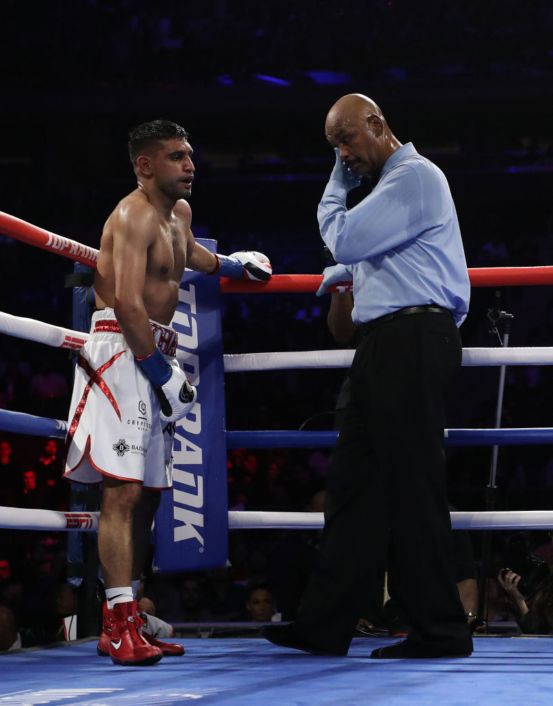 Terence Crawford beats Amir Khan via technical knockout after low blow