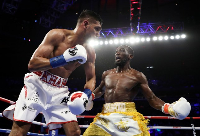 Terence Crawford winds up a counter against Amir Khan