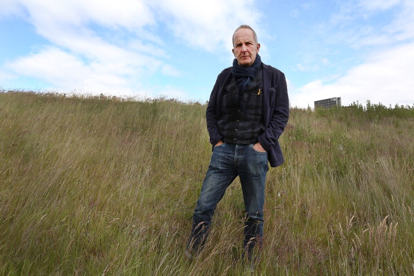 How long has Kevin McCloud been presenting Grand Designs and when did he get an MBE?