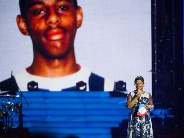 Baroness Doreen Lawrence speaks in front of an image of her son Stephen