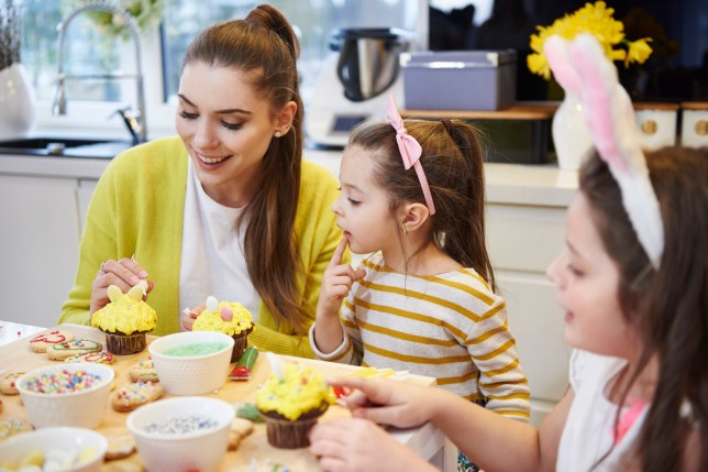 A family decorating bunny cakes for Easter weekend
