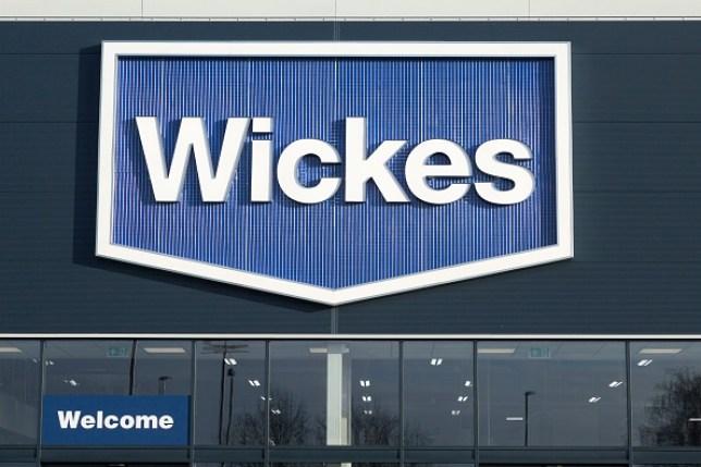 Wickes shop sign outside store in Martlesham, near Ipswich, Suffolk, England, UK