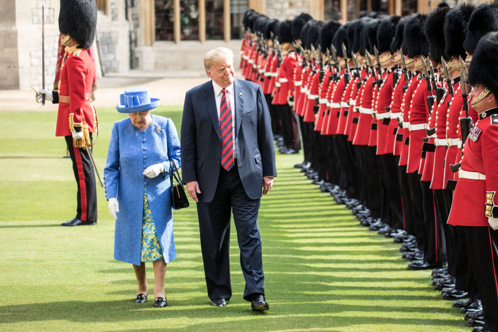 U.S. President Donald Trump and Queen Elizabeth II walk alongside each other as they inspect a Guard of Honour at Windsor