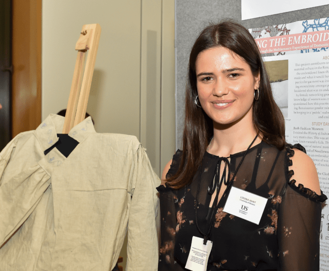 Louisa Hunt poses with a Renaissance-era shirt she made by hand