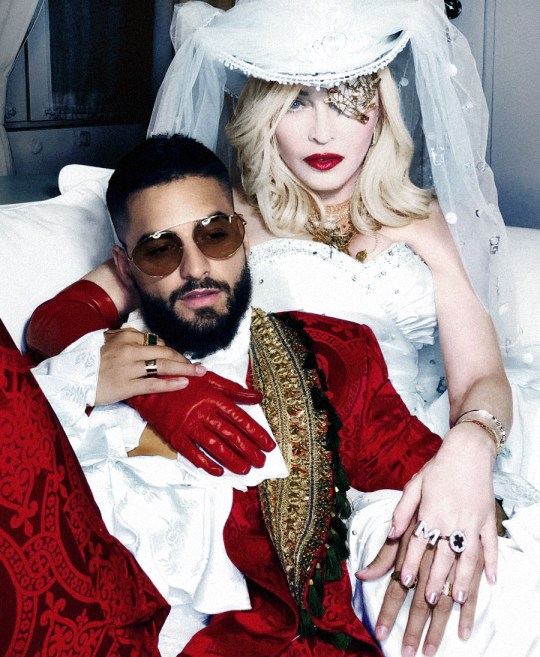 madonna posing with maluma in the promo for their song medellin