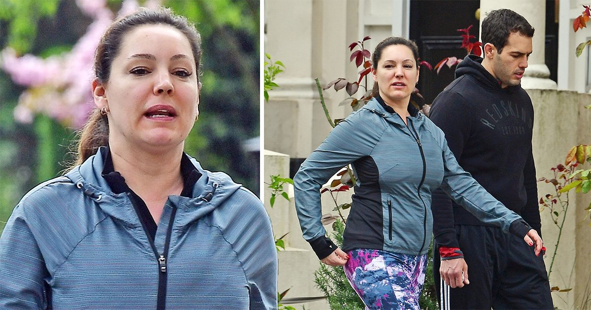 Make-up free Kelly Brook and boyfriend Jeremy Parisi in London