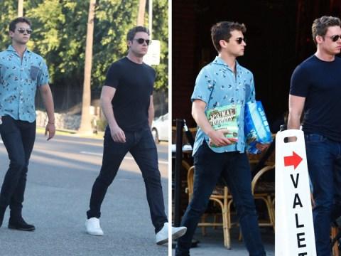 Richard Madden and pal Brandon Flynn venture out on fashionable dog walk in LA