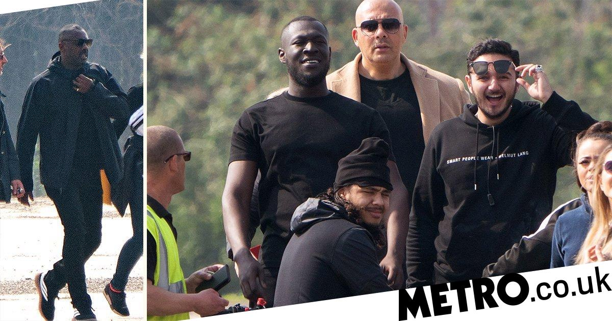 Idris Elba and Stormzy are the men in black filming at east London music video shoot