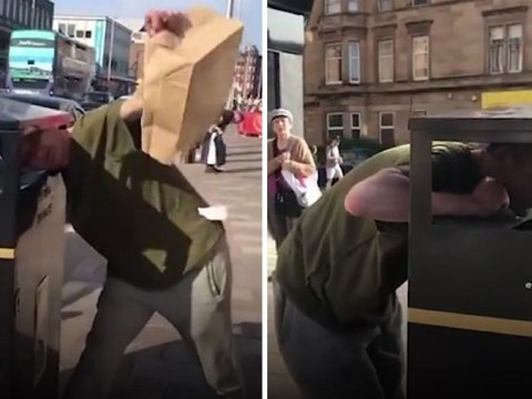 Man filmed having a rubbish day after getting his head stuck in bin