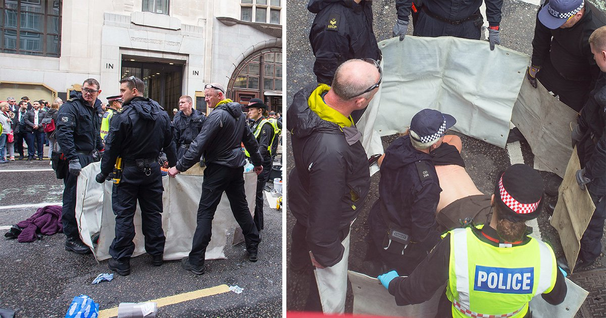 Protester glues her breasts to ground outside Goldman Sachs