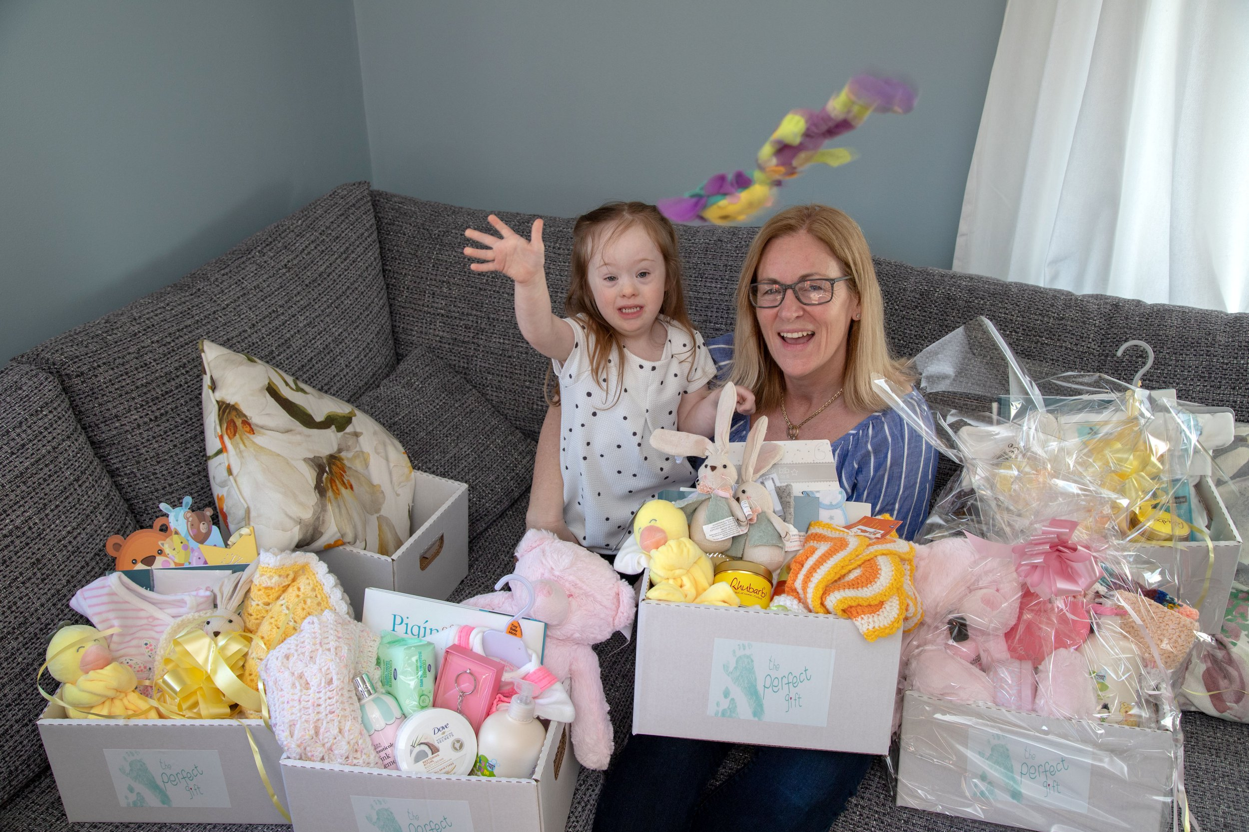 PIC FROM Caters News - (PICTURED: Sinead Fidgeon, 47, from Cavan, Ireland, with her daughter Grace, 5) -An Irish mum has made over 500 gift baskets for new mums to Downs Syndrome children after feeling their births arent celebrated enough. Sinead Fidgeon, 47, from Cavan, Ireland, decided to make the baskets of love for other mums following the birth of her own Downs Syndrome daughter, Grace, now five.SEE CATERS COPY