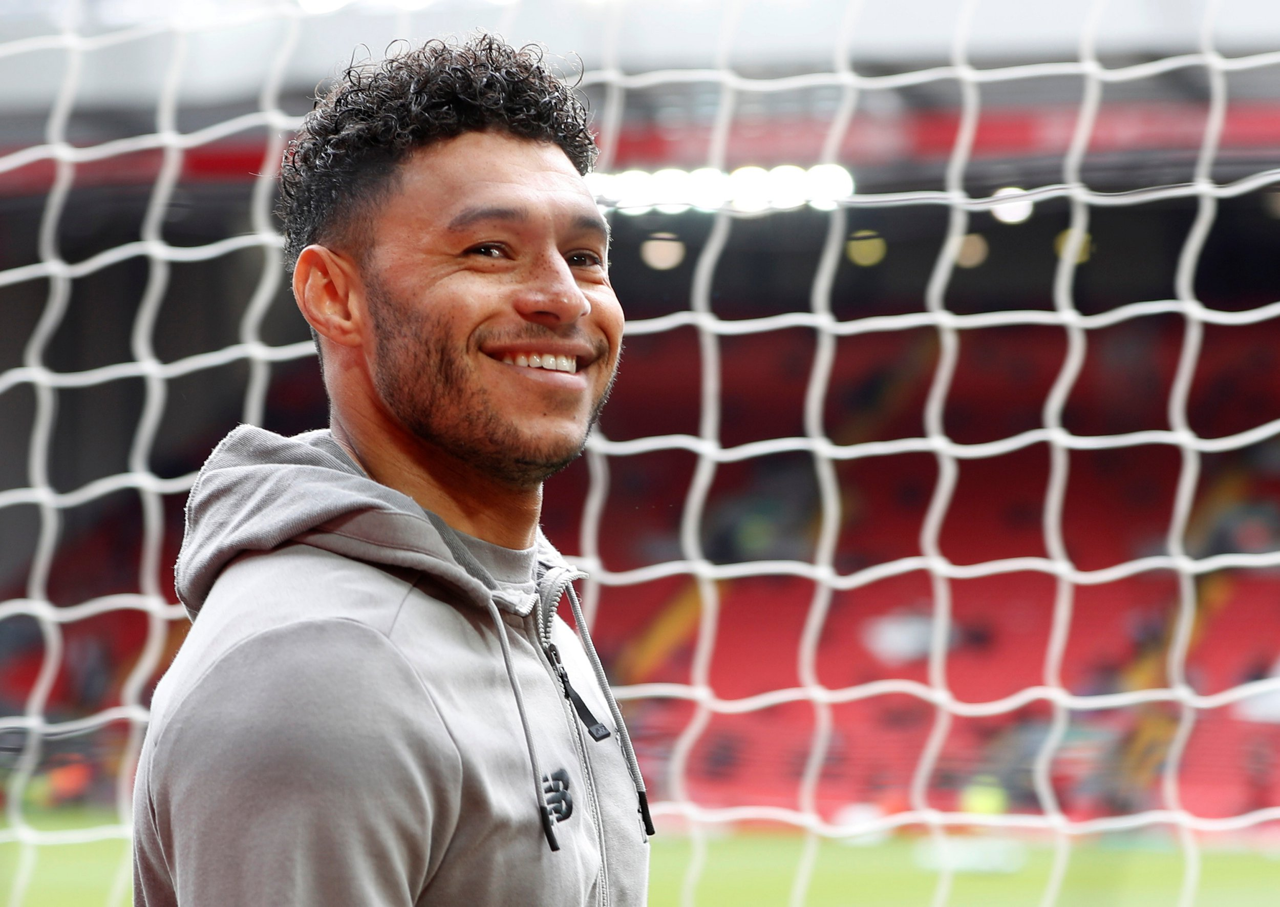 """Soccer Football - Premier League - Liverpool v Tottenham Hotspur - Anfield, Liverpool, Britain - March 31, 2019 Liverpool's Alex Oxlade-Chamberlain before the match Action Images via Reuters/Paul Childs EDITORIAL USE ONLY. No use with unauthorized audio, video, data, fixture lists, club/league logos or """"live"""" services. Online in-match use limited to 75 images, no video emulation. No use in betting, games or single club/league/player publications. Please contact your account representative for further details."""