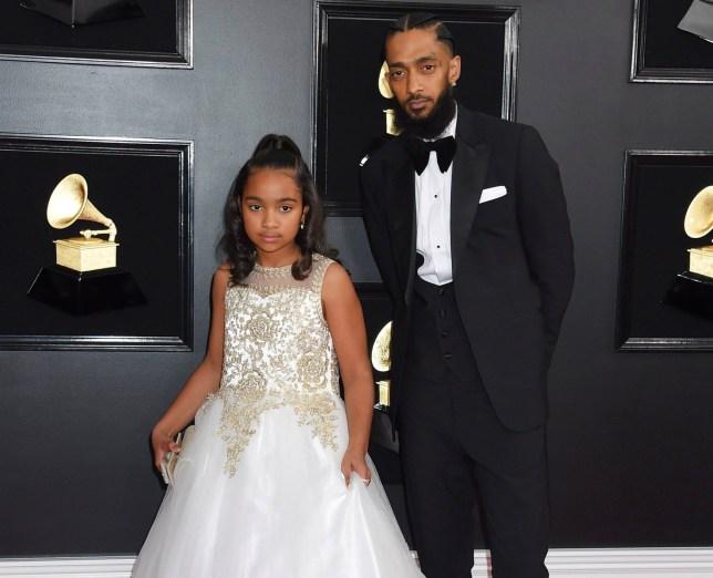 Nipsey Hussle and daughter Emani