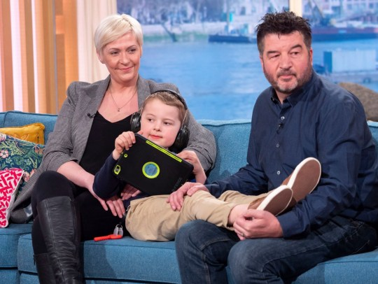 Editorial use only Mandatory Credit: Photo by Ken McKay/ITV/REX (10183713t) Alex Duthie with parents Anna and Adrian 'This Morning' TV show, London, UK - 01 Apr 2019 ?CHESTER THE DOG HELPED MY AUTISTIC SON SPEAK? As World Autism Awareness Week gets underway, today we?re hearing from the inspirational seven-year-old Alex Duthie. Alex?s autism has previously left him housebound and totally non-verbal - that?s until his best friend came along to change his life. Since getting Chester the labrador support dog, Alex has come on leaps and bounds - he can now get out and about more, and has even learned to say his beloved dog?s name. Alex joins us today with his best-friend Chester, and his parents Anna and Adrian.