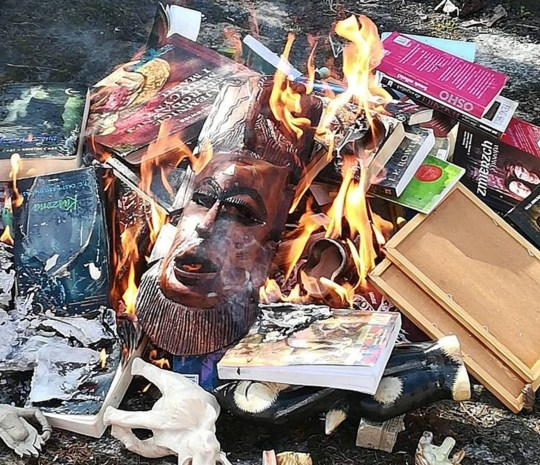 "Pic shows: Books like ""Harry Potter"" and ""Twilight"" have been burnt on a stack in front of a church. POLAND: A Catholic group has sparked outrage after organising a church book burning protest where ???Harry Potter??? and ???Twilight??? novels were thrown on a fire for being contrary to the Word of God."